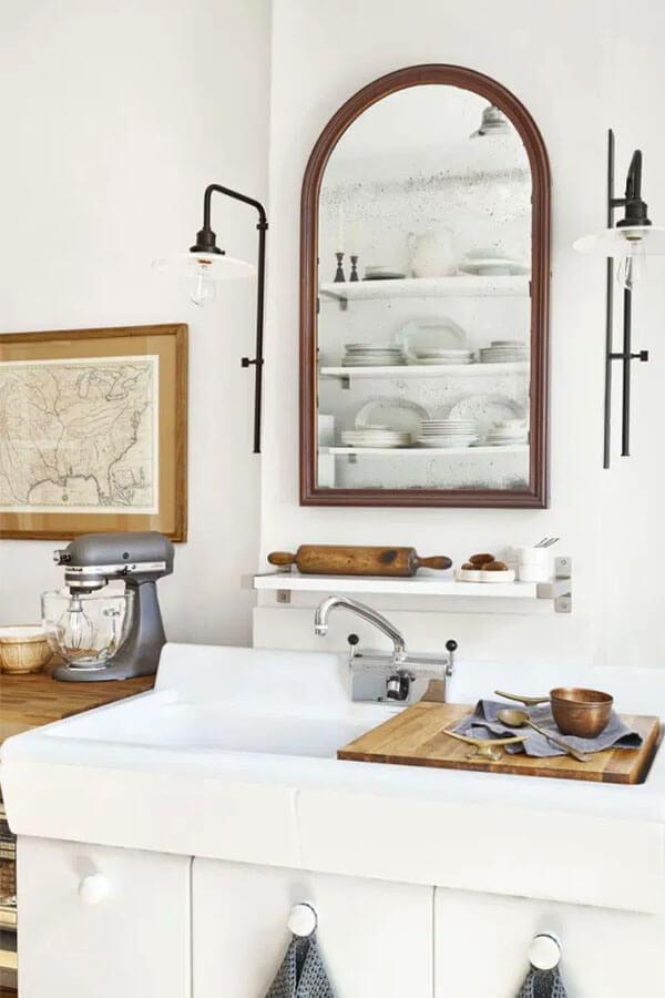 Mirror over the windowless kitchen sink