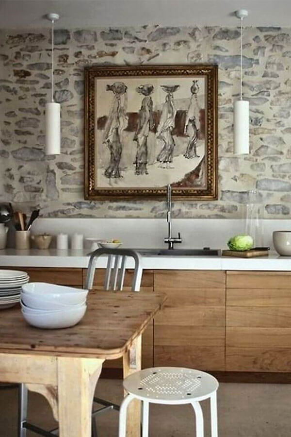 wall art over the rustic kitchen sink